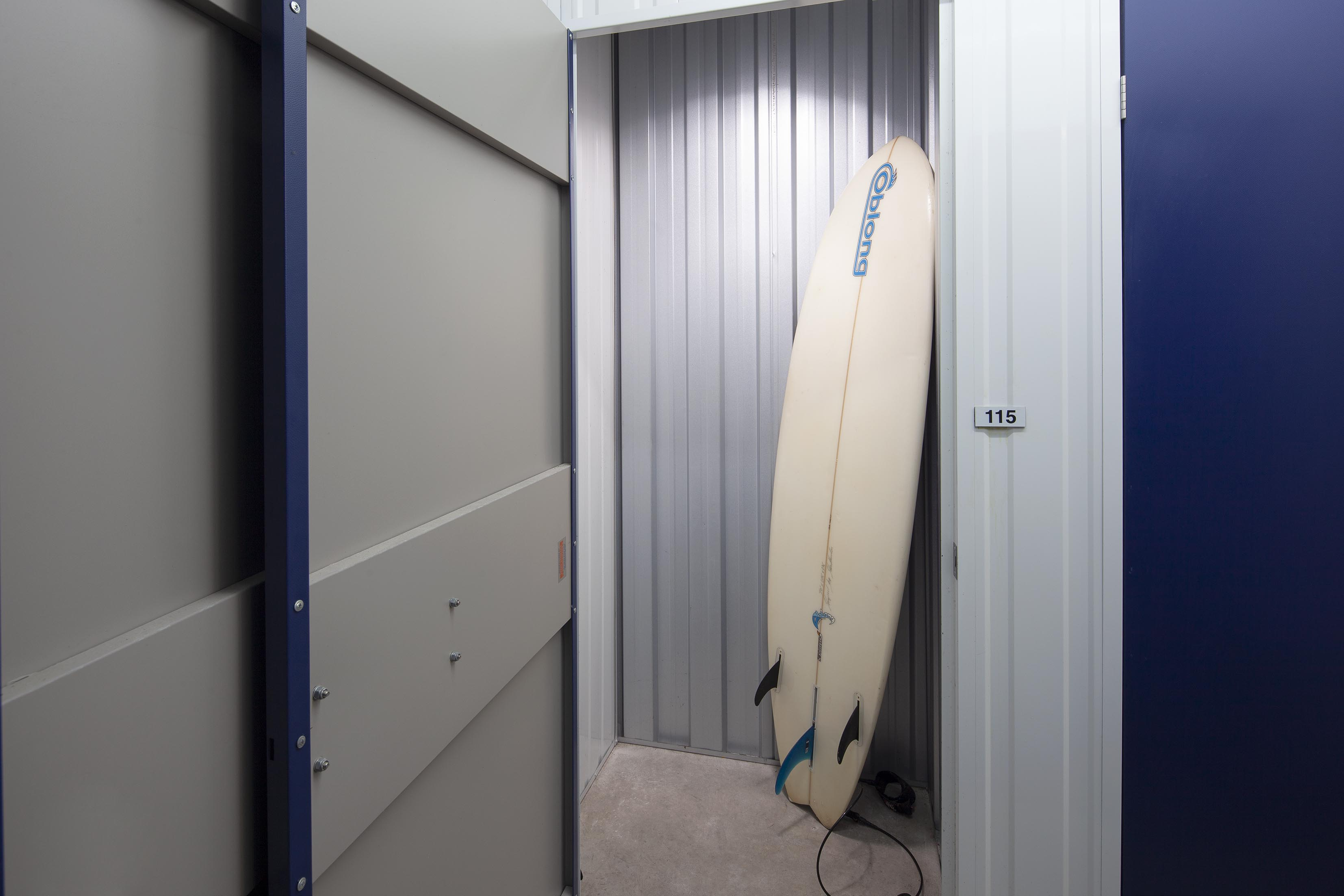 11sqft storage unit with a surf board stored in it