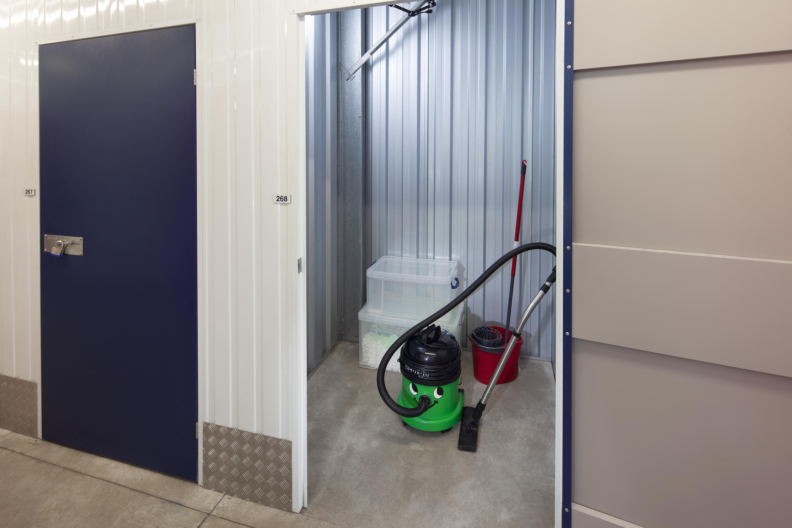 25 sqft storage unit with a hoover and boxes inside of it.