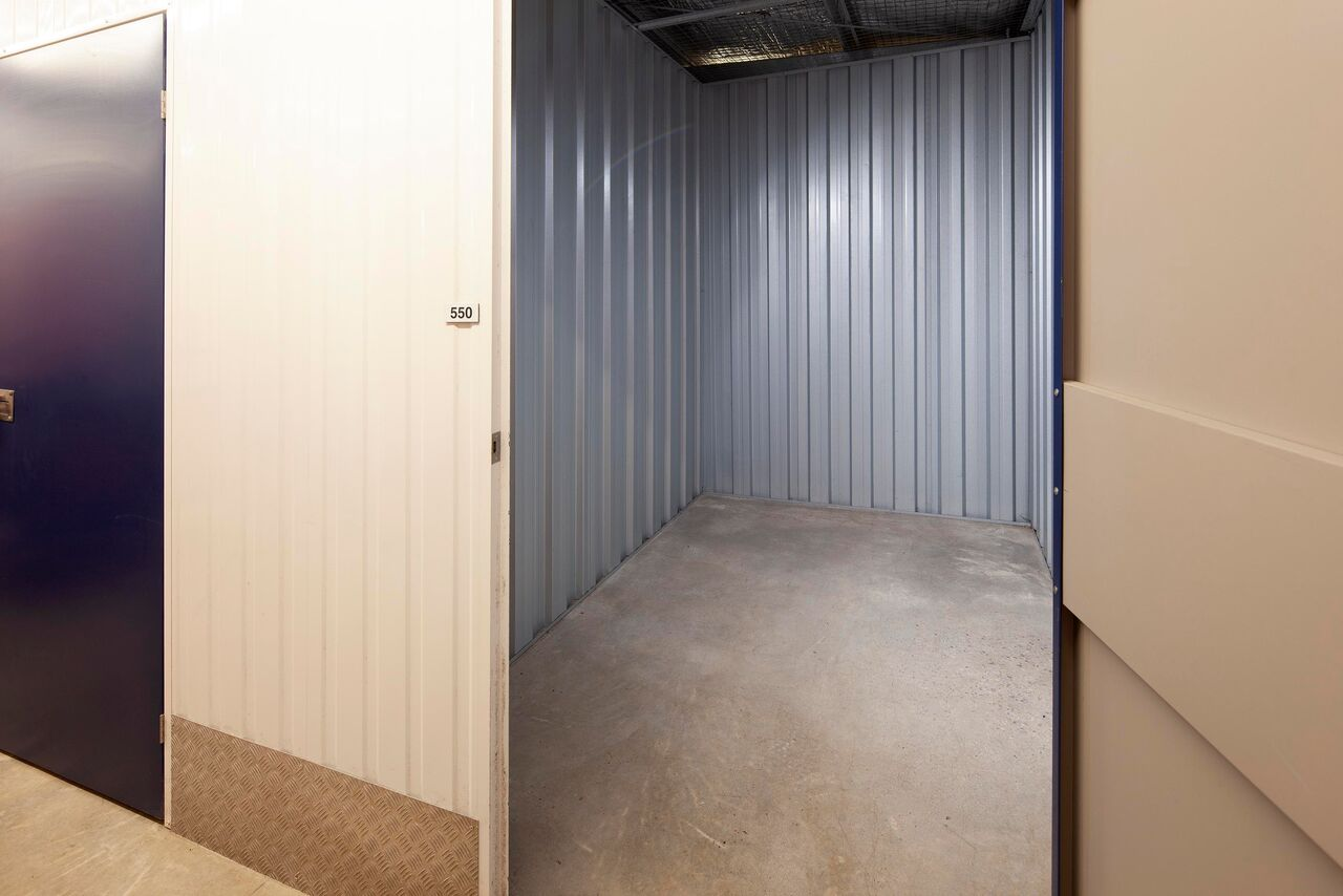 50ft storage unit with motorbike stored in it.